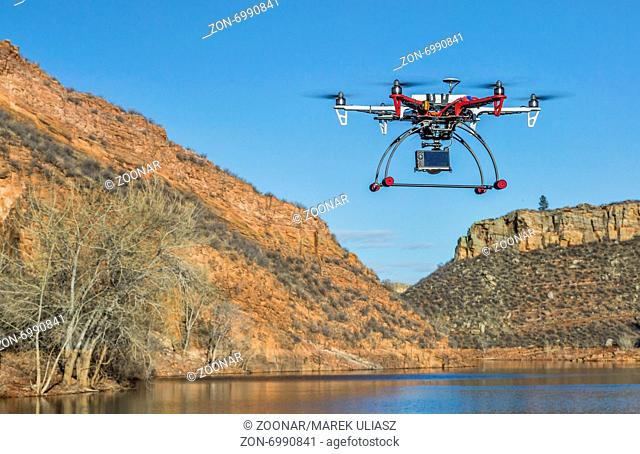 drone flying over mountain lake