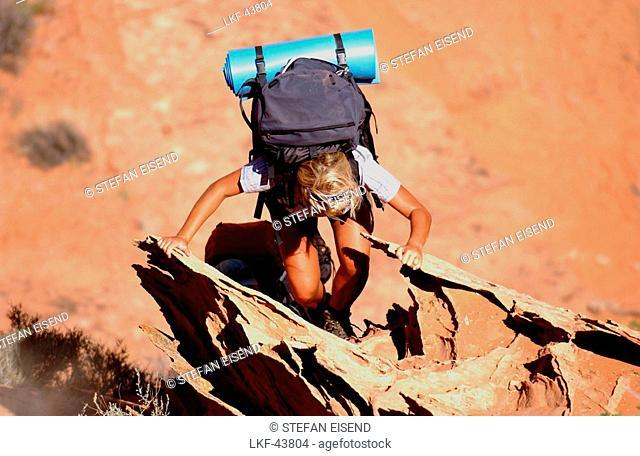 A woman hiking at Lake Powell, Arizona, Utah, USA, MR