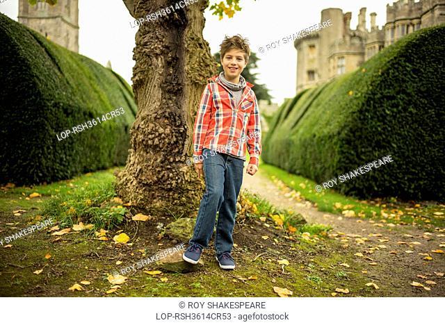 England, Gloucestershire, Thornbury. A young boy in a castle garden