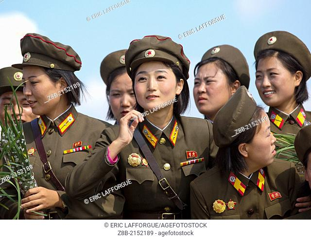 Smiling North Korean Female Soldiers In Tower Of The Juche Idea, Pyongyang, North Korea