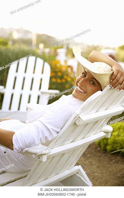 Young woman sitting in deck chair
