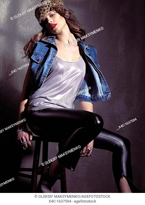 Fashion photo of a young woman in 1990s grunge fashion style clothing