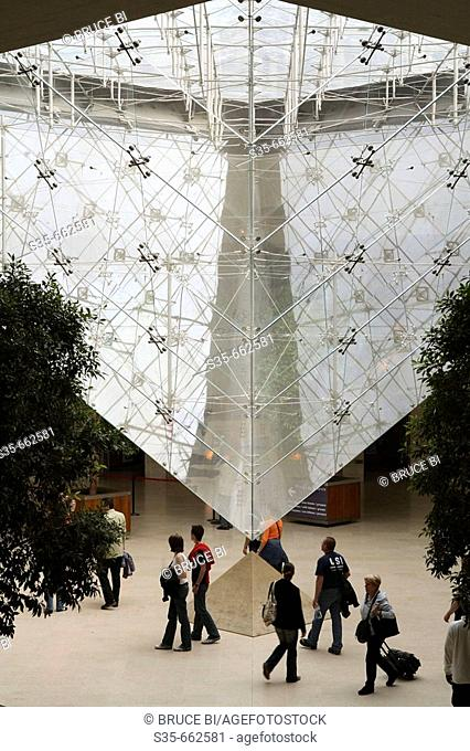 The inverted glass pyramid in Musee du Louvre. Paris. France