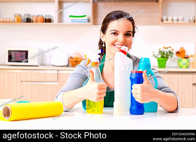 The young female contractor doing housework