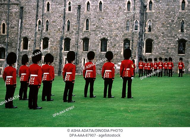 Guards marching at Windsor Castle , U.K. United Kingdom England