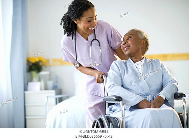 Wheelchair Orderly Nursing Home Stock Photos And Images Agefotostock