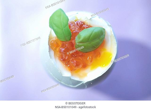 cooked egg with salmon caviar