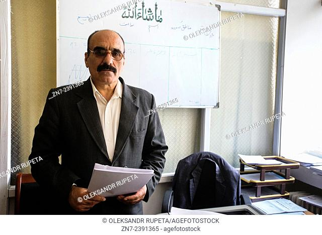 Portrait of Abdul Maalek, logistic officer in health directorate of Afghan Red Crescent Society, Kabul, Afghanistan