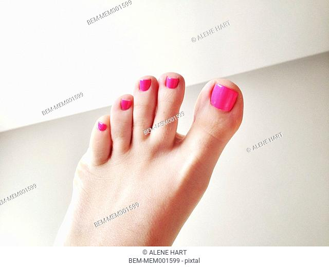 Close up of painted toenails of woman