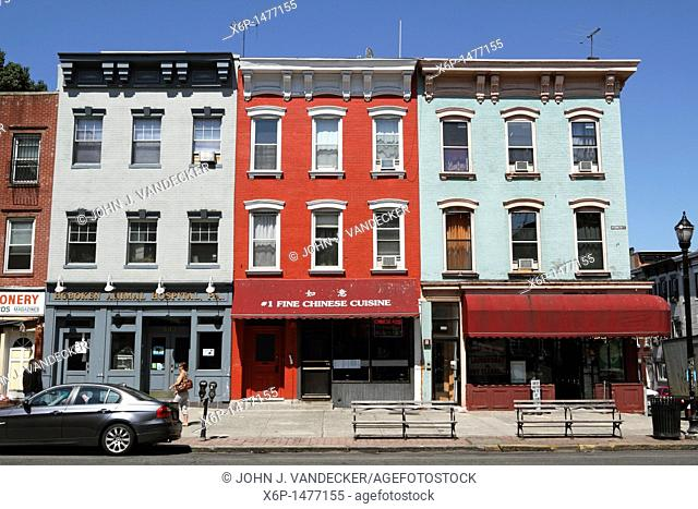 Row Houses and apartment building line Washington Street, the main thoroughfare in Hoboken, New Jersey, USA  Most buildings house shops as the street serves as...