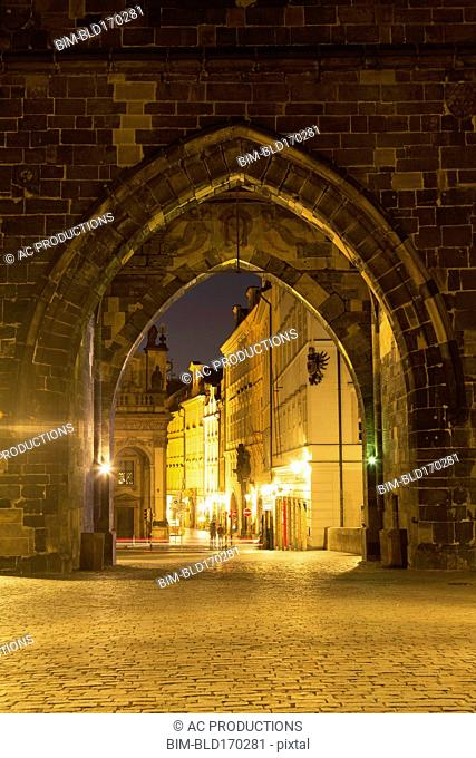 Arches in stone wall outside city