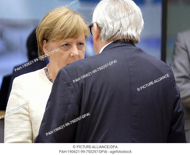20 June 2019, Belgium, Brüssel: Angela Merkel (CDU), Chancellor of the Federal Republic of Germany, speaks with the President of the European Commission...