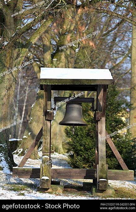 26 January 2021, Brandenburg, Birkholz: The bell of the church in the Bernau district of Birkholz. The church is considered to be one of the oldest fieldstone...