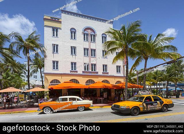 Vintage car & yellow cab on Ocean Drive, South Beach, Miami Beach, Miami, Florida, United States of America, North America
