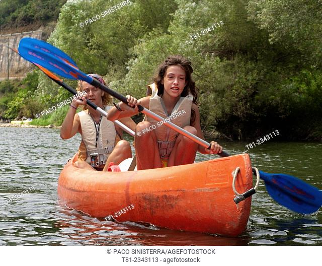 mother and daughter canoeing down the River Sella, Ribadesella, Cantabria, Spain