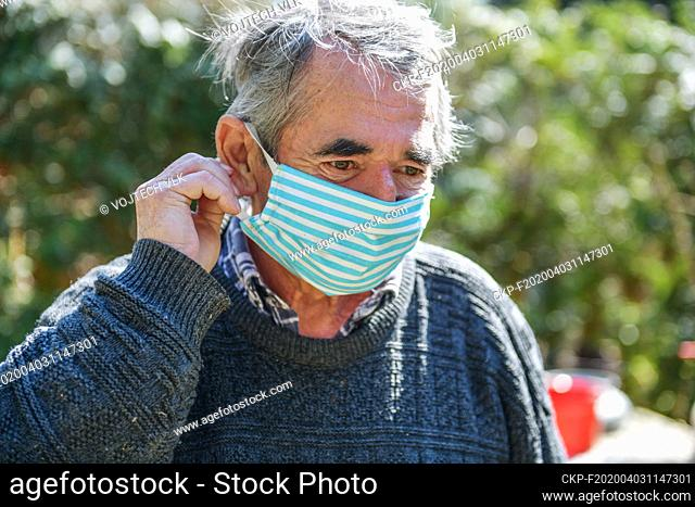 Portrait of an old man, 75 years old, in a protection face mask. (CTK Photo/Vojtech Vlk)