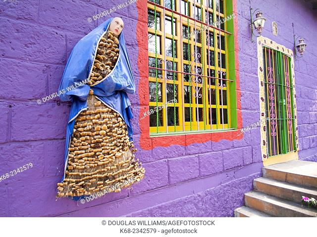 Sculpture and wall of an artist's house in San Miguel de Allende, Guanajuato state, Mexico