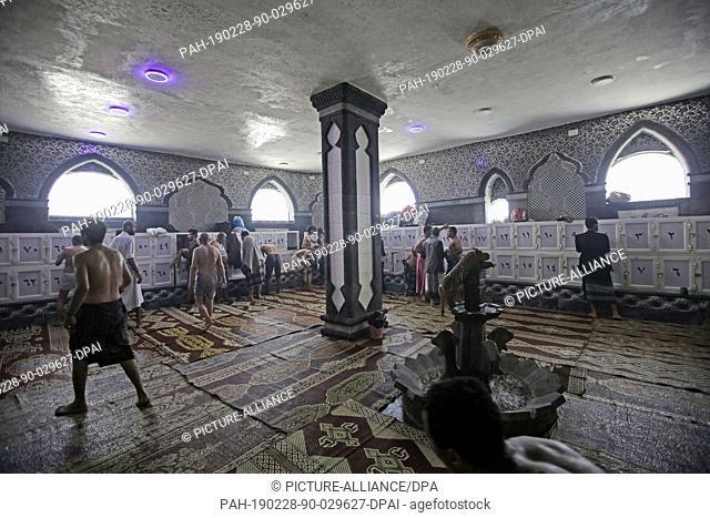 28 February 2019, Yemen, Sanaa: Yemenis stand in the locker room at a traditional Turkish-style steam bath. Yemenis go to a traditional Turkish-style steam bath...