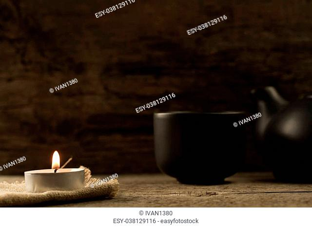 light burning brightly candles on old wooden background. Spa, meditation, ritual, flavored