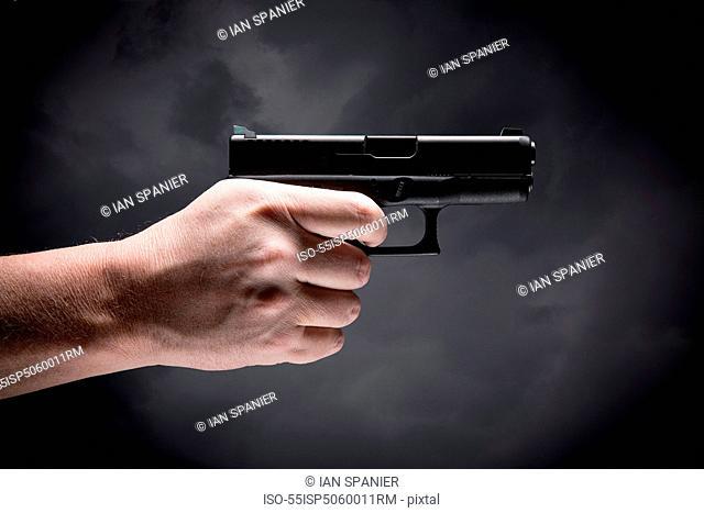 Person holding handgun