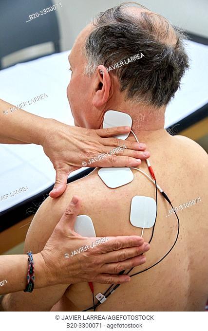 physiotherapist with patient, electro stimulation, Rehabilitation, Amara Berri Health Center building, Donostia, San Sebastian, Gipuzkoa, Basque Country, Spain