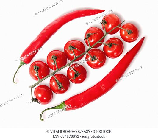 Two chili pepper and cherry tomatoes on stem top view isolated on white background