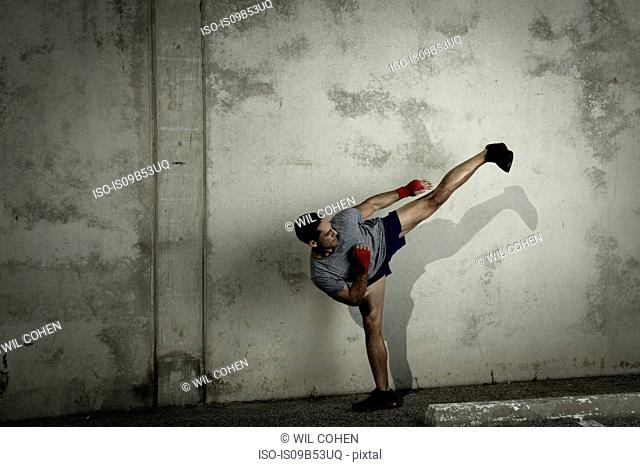 Kickboxer, in urban environment, in fighting stance