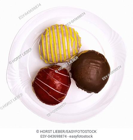 Three special jam doughnut filled with vanilla raspberry jelly, advocaat, chocolate on white background cutout, Baden Wuerttemberg, Germany, Europe
