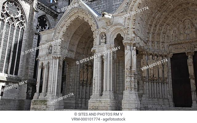 Exterior, PAN, Daylight, view of the Chartres Cathedral's - northern transept Facade. Seen is the triple-portal porch, surmounted by a sharply defined stone...