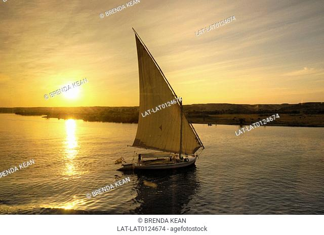 Feluccas or traditional boats have triangular sails and often offer tourist boat trips at the end of a hot day to watch the sun setting
