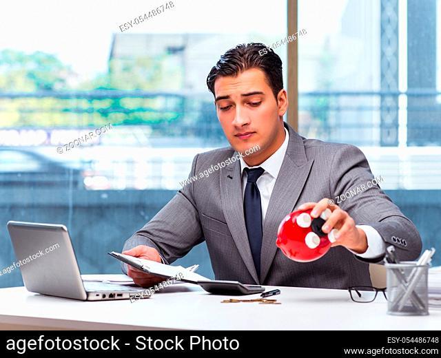 The bankrupt broke businessman with piggy bank