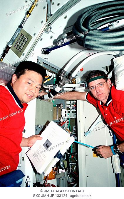 Astronauts Leroy Chiao (left) and William McArthur, who earlier shared space walk time to work on the exterior of the International Space Station (ISS)