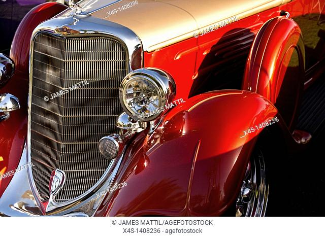 Close-up of left front quarter fender, grille and headlamps of a classic car