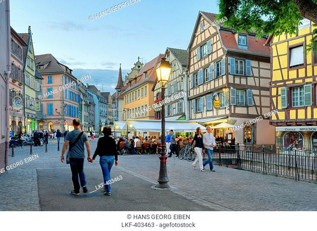 People at the Place de l'Ancienne Douane in the evening, Colmar, Alsace, France, Europe
