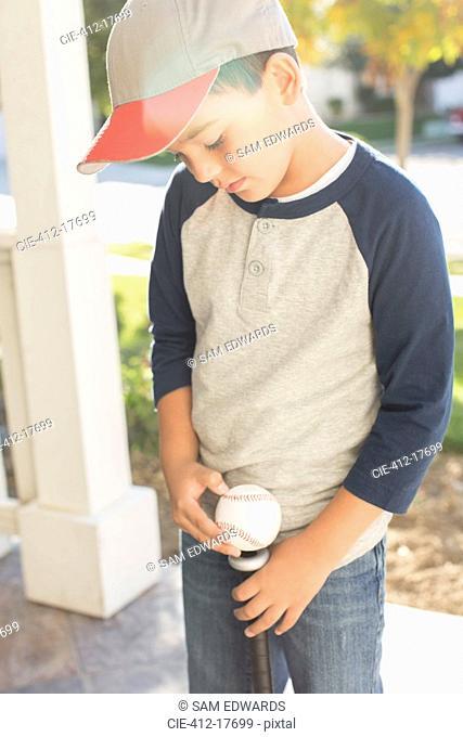 Boy with baseball and bat