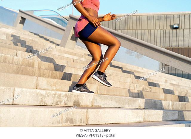 Young woman during workout on stairs