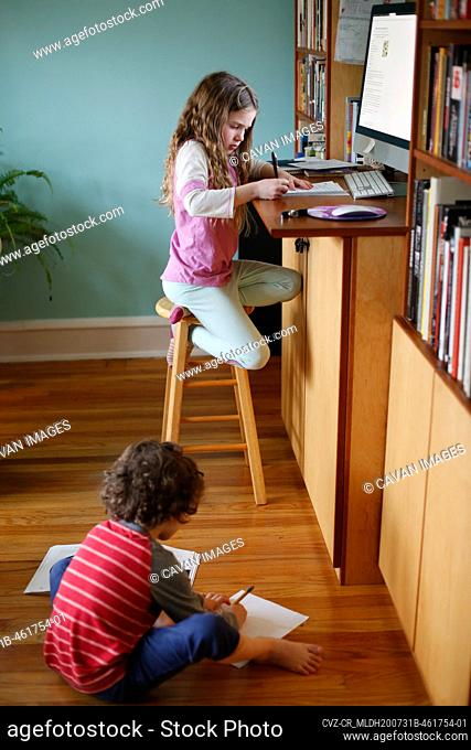 Children doing school work at home during the pandemic