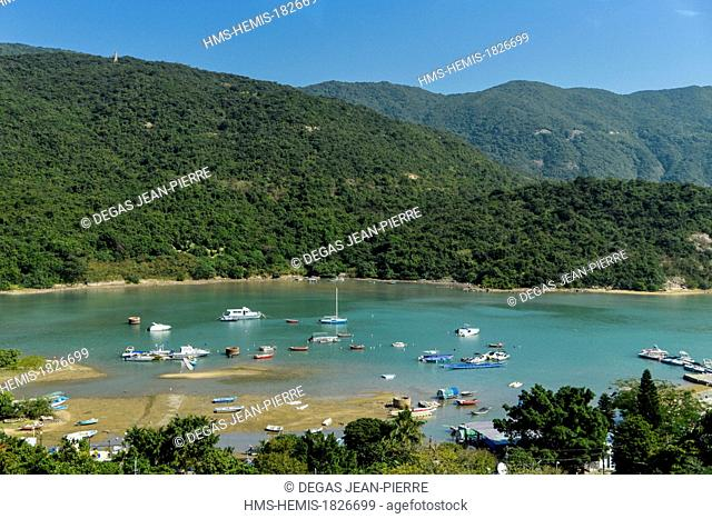 China, Hong Kong, Hong Kong Island, Bay of Tai Tam, small fishing port in a handle with the mountains of the Dragon's Baack in the background