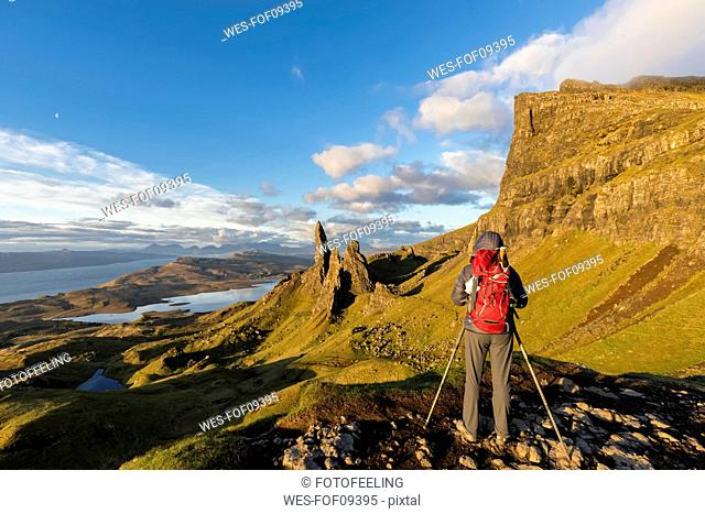 UK, Scotland, Inner Hebrides, Isle of Skye, Trotternish, tourist taking pictures near The Storr