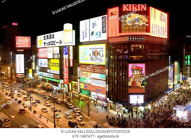 Tusukisamu dori at Sapporo Ekimae dori, Illuminated signs on buildings in Susukino entertainment district , Sapporo, Hokkaido, Japan