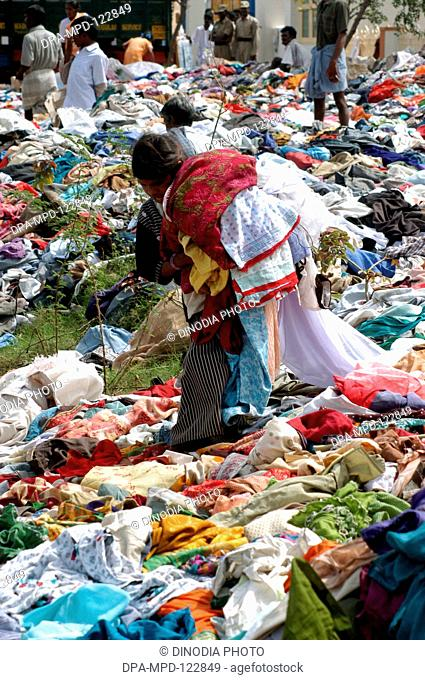 A boy selecting clothes from the stacks of clothes that arrived Nagapatinam following the Tsunami disaster as help from the people of the country as help for...