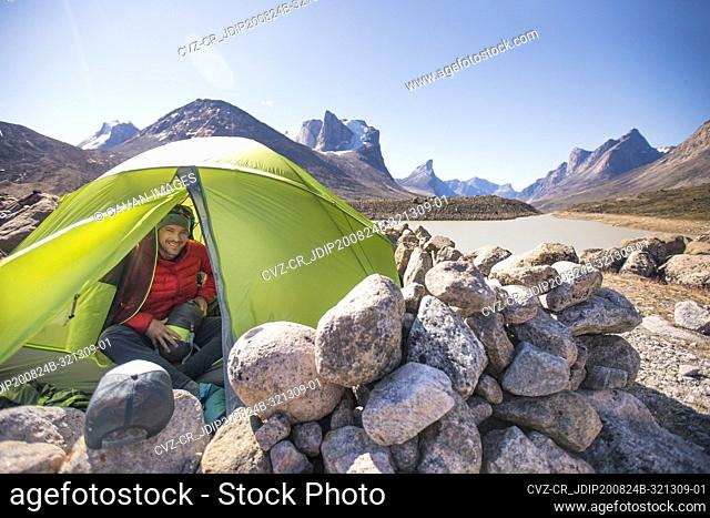 Portrait of climber in his tent at Summit Lake, Akshayak Pass