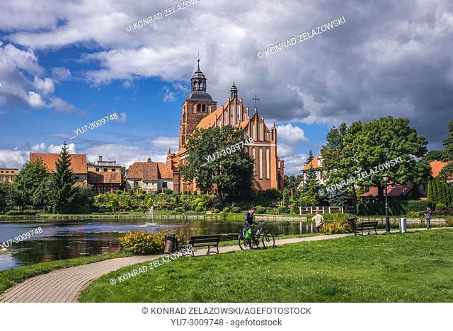 Gothic Church of Saint Anne and Saint Stephen over so called Prison Pond in Barczewo town, Warmian-Masurian Voivodeship of Poland