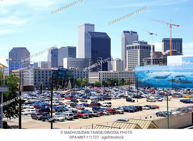 Car parking near buildings ; New Orleans ; Louisiana ; U.S.A. United States of America