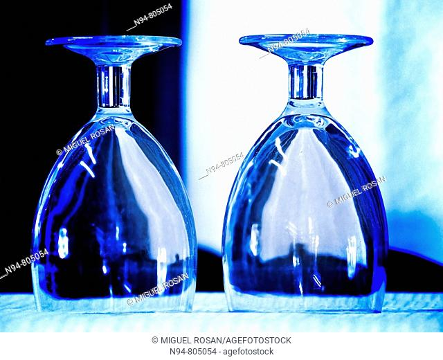Tack blue image of two glasses on the table upside down Restaurant Don Baco La Cañada. Valencia. Spain. Europe