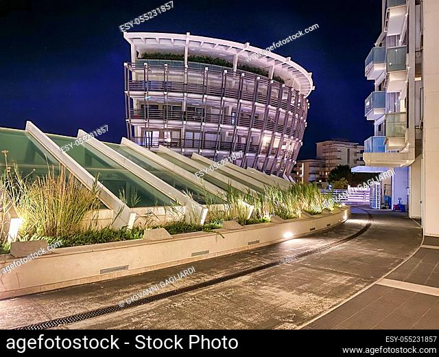 RIMINI, ITALY - AUGUST 26, 2020: Night view of city port and buildings