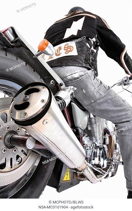 Harley Davidson driver with his motor bike