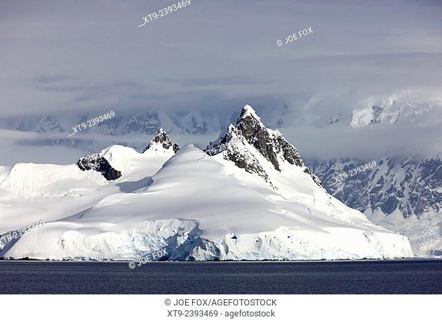 sharp mountain peaks and snow caps on arctowski peninsula wilhelmina bay Antarctica