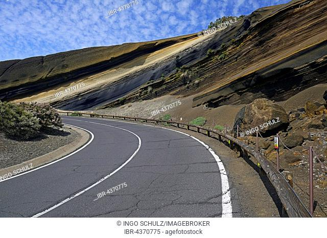 Road curving through different layers of sandstone, Pico del Teide volcano, Teide National Park, Tenerife, Canary Islands, Spain