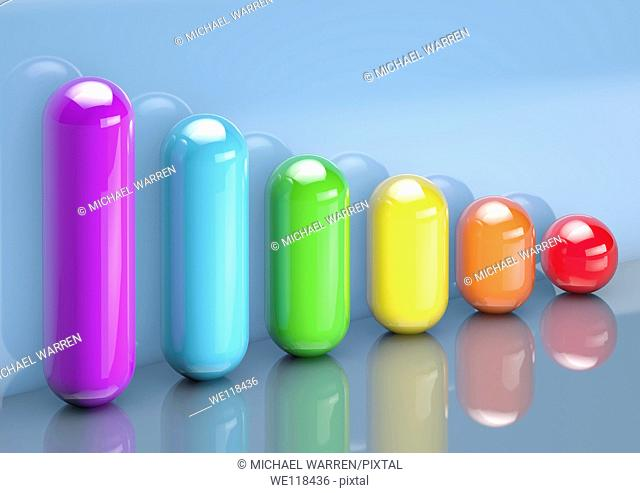 Series of muti-coloured capsules forming a descending bar graph - 3D render - Concept image